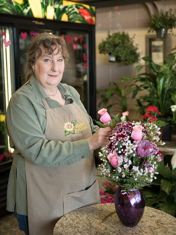 Gillian arranges flowers